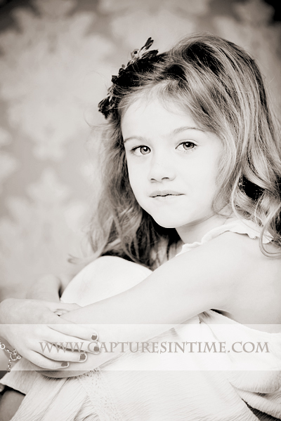 Kansas City Child Photographer sepia girl on damask backdrop