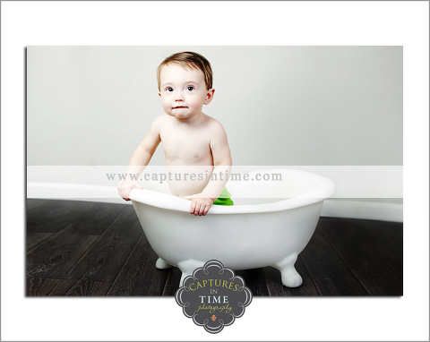 baby boy in a bathtub grey backdrop