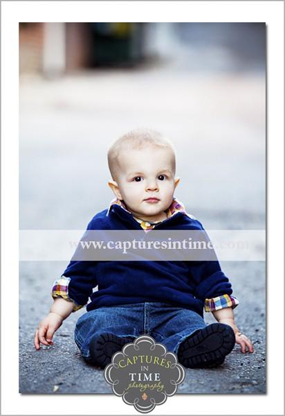Baby sitting in alley Rivermarket