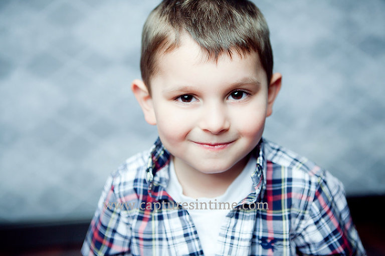 boy on grey argyle backdrop