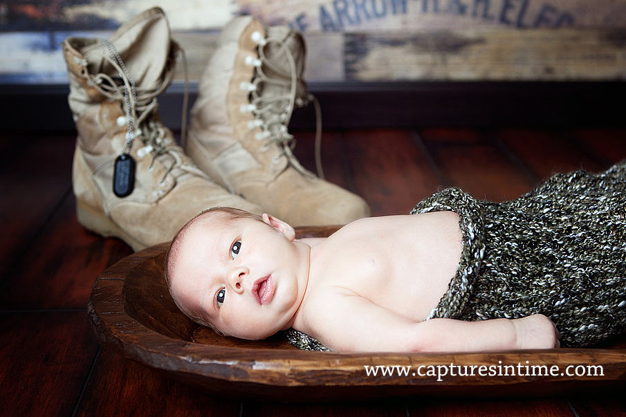 baby with dad's military boots