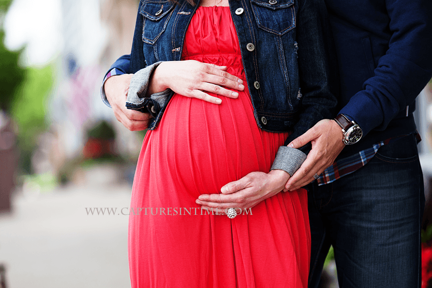 kansas city maternity session mom in red dress close up of belly