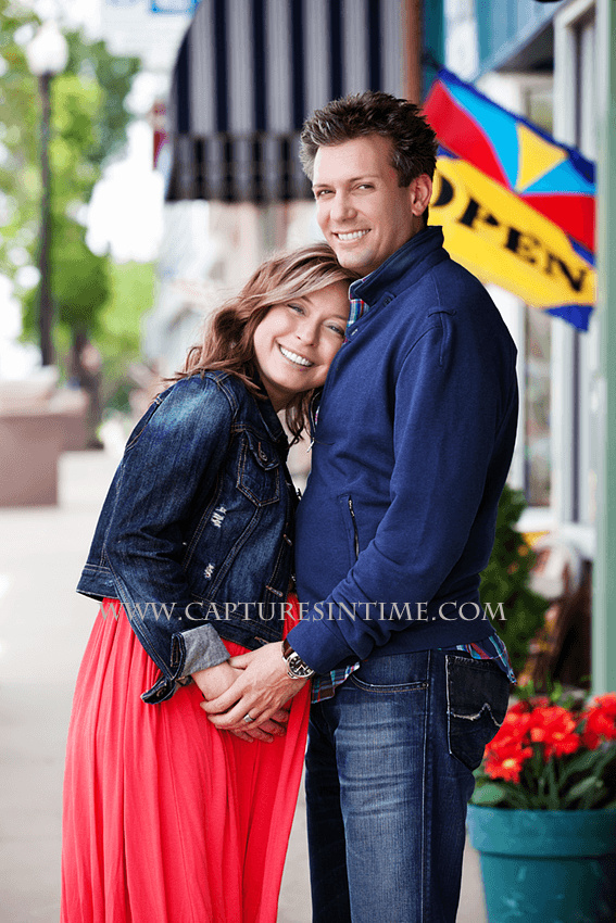 kansas city maternity session mom in red dress snuggling into dad