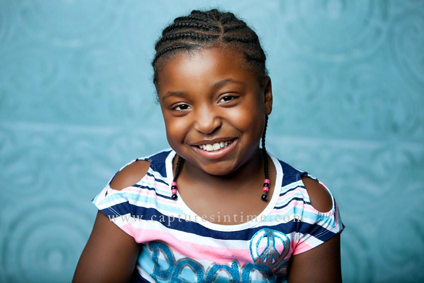 Blue Springs Child Photographer girl on blue tile backdrop