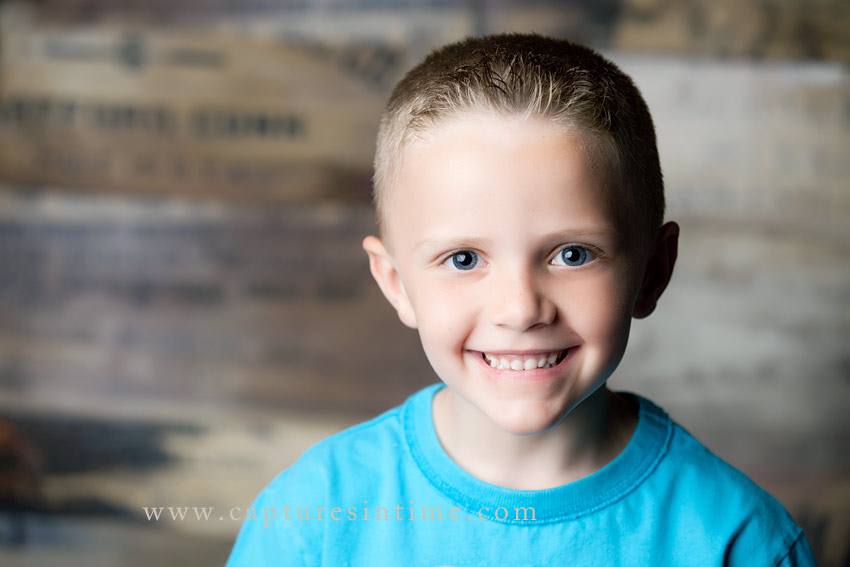 Blue Springs Child Photographer boy with big eyes on palette backdrop