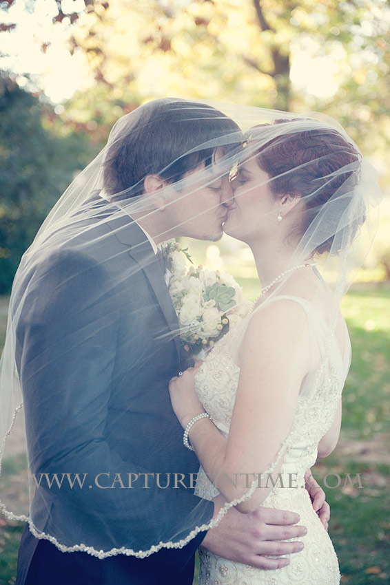 Simpson House Kansas City bride and groom kissing under veil