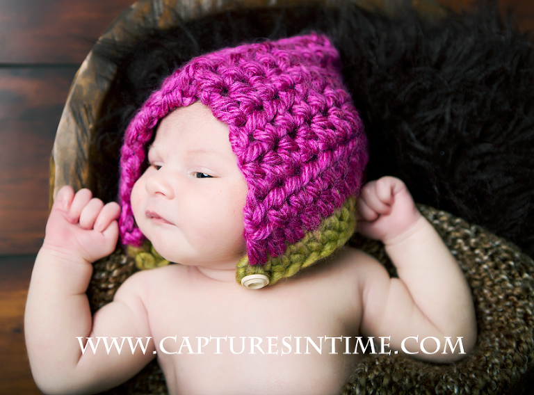 newborn and pink hat