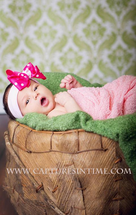 Kansas City Newborn Girl Photos baby girl on green blanket with damask backdrop