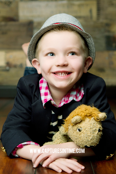 boy with hat and stuffed animal