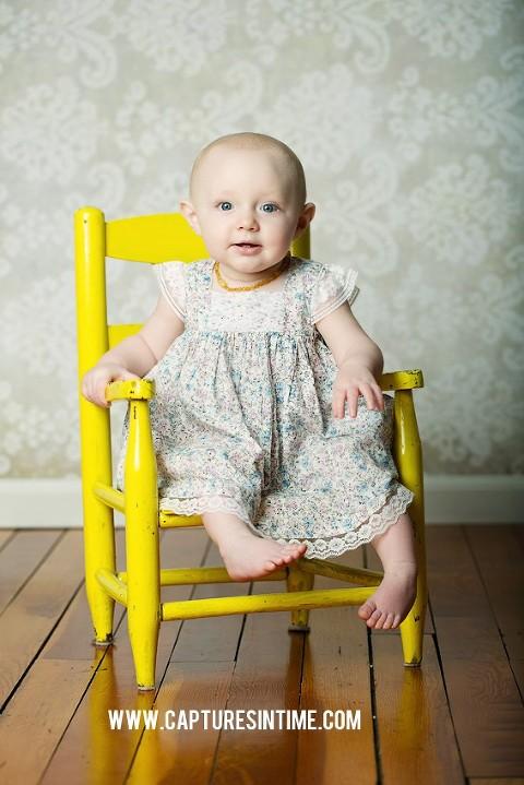 Kansas City baby in yellow chair by Melissa Pfannenstiel Photographer