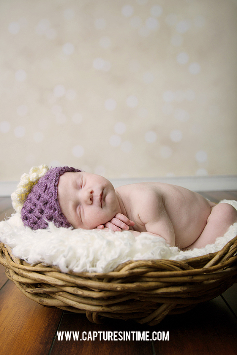 newborn in purple hat