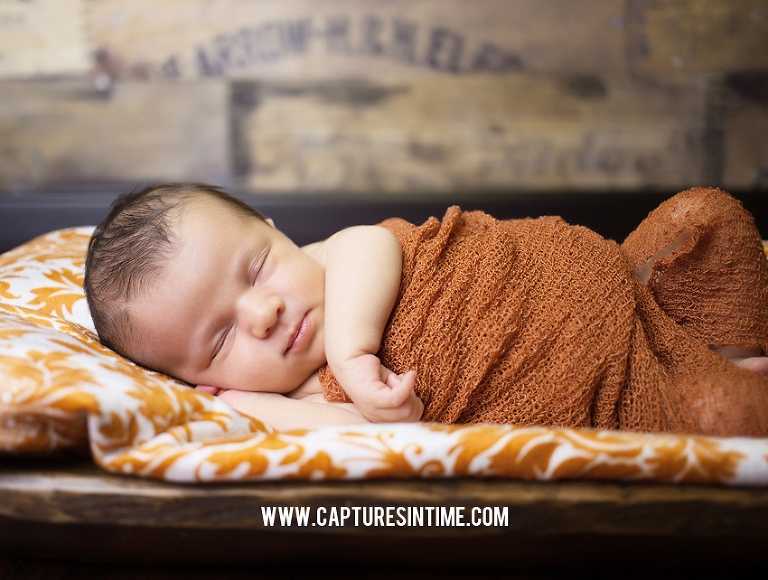 kansas city newborn on orange blanket