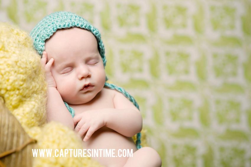 newborn on yellow blanket