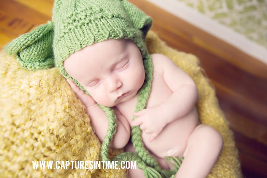 newborn in yoda hat