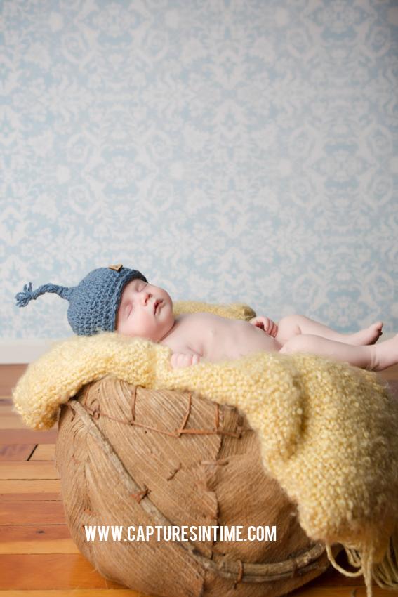newborn in blue hat