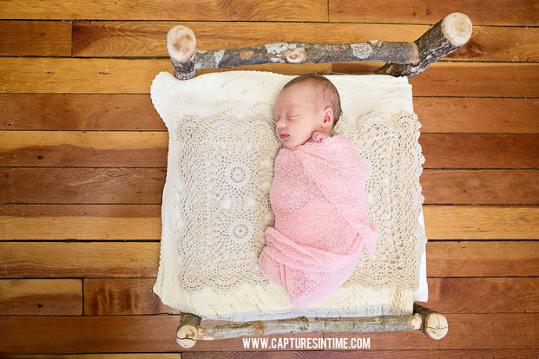 Grain Valley Newborn Photography newborn baby girl on crochet blanket lying on a birch bed