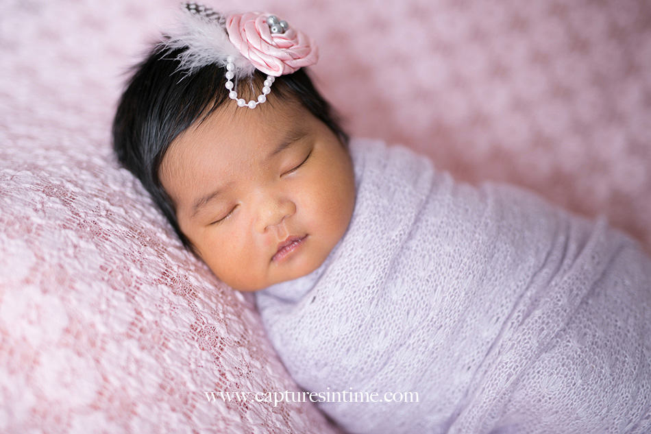 kansas city newborn photographer Mia newborn baby dark hair and feather and pearl headband