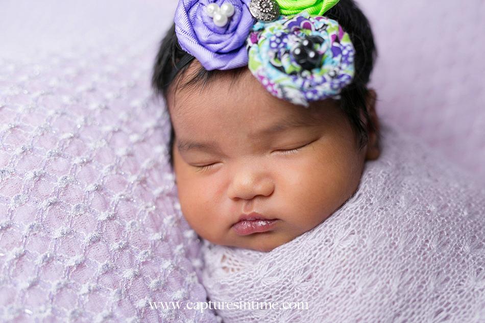 kansas city newborn photographer Mia newborn baby dark hair and floral trio headband