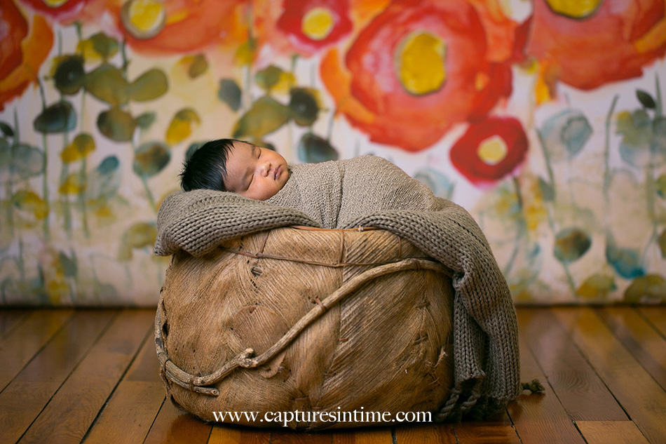 kansas city newborn photographer Mia newborn baby dark hair on poppy backdrop sleeping soundly