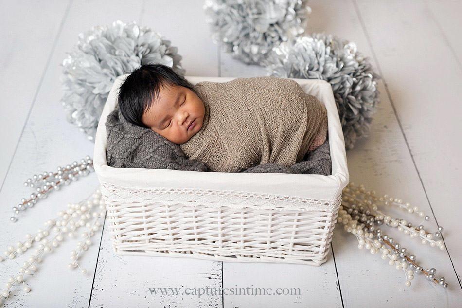 kansas city newborn photographer Mia newborn baby dark hair in white basket