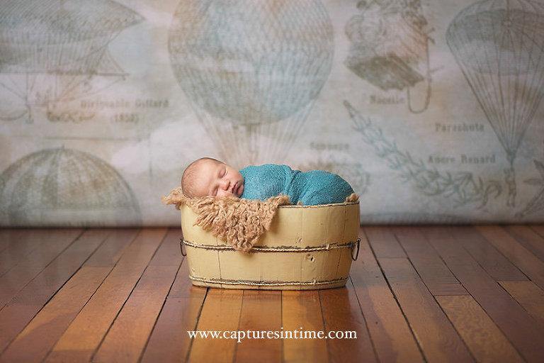 Newborn Baby Boy Photos boy in front of balloon backdrop