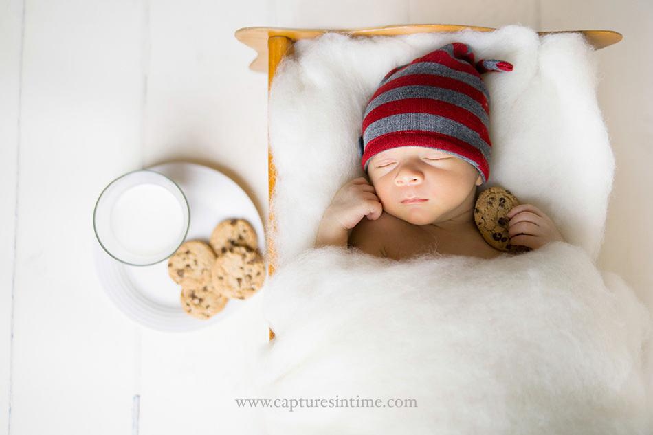 Christmas Cookies Newborn Photos baby holding cookies with milk