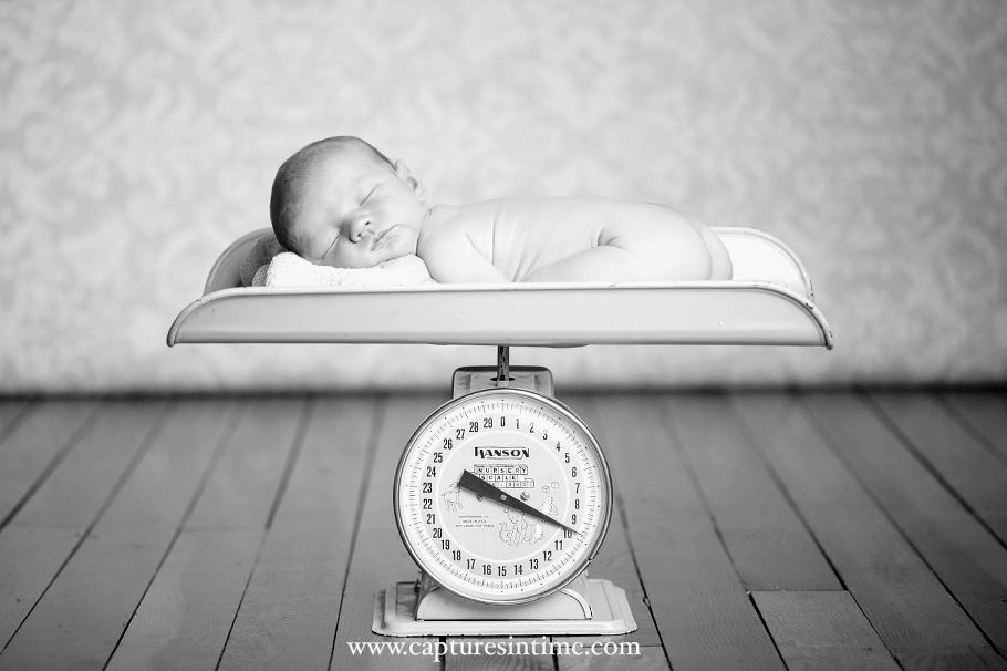 Kansas City Golf Newborn Photography black and white image of baby on a scale