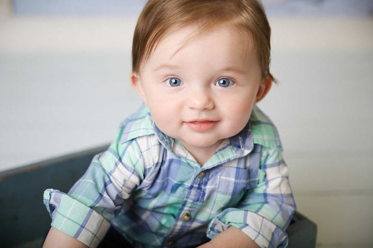 baby photography kansas city red head baby boy with plaid shirt on sitting in a box