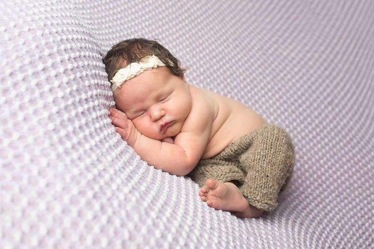 newborn girl on lavender brown pants
