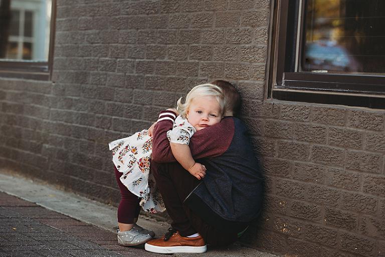 little boy hugging his sister